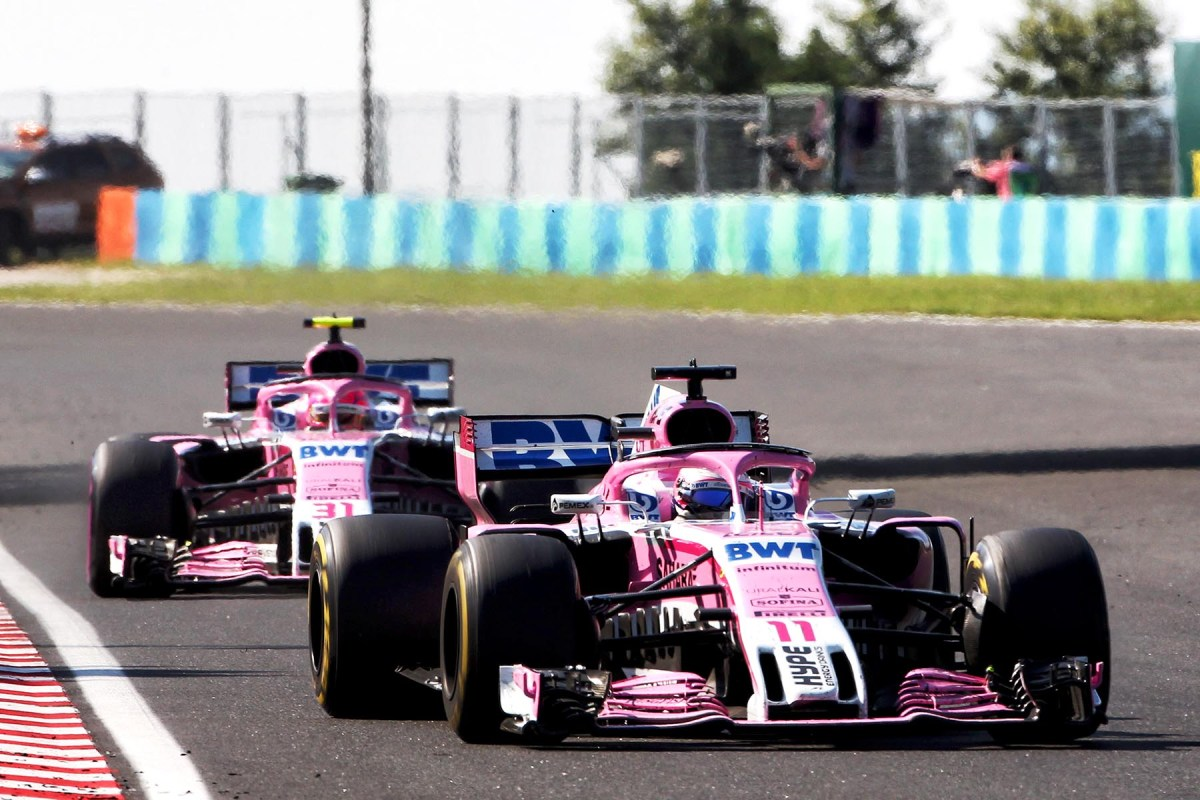 Esteban Ocon and Sergio Perez on track at the 2018 Hungarian Grand Prix.