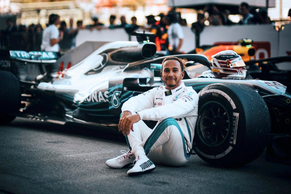 Lewis Hamilton sits by his car after winning the 2018 Japanese Grand Prix.