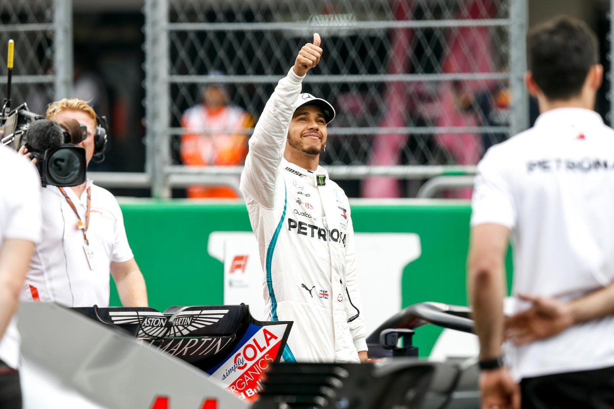 Lewis Hamilton waves to fans after qualifying third at the 2018 Mexican Grand Prix.