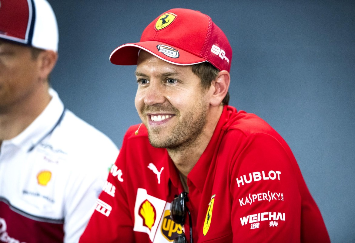 Sebastian Vettel smiles in the press conference ahead of the 2019 German Grand Prix.