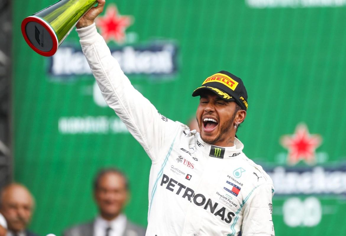 Lewis Hamilton celebrates on the podium at the 2019 Mexican Grand Prix.
