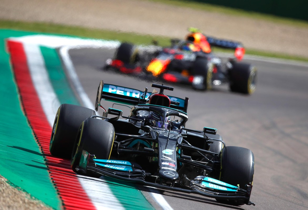 Lewis Hamilton leads Max Verstappen on track in Imola.