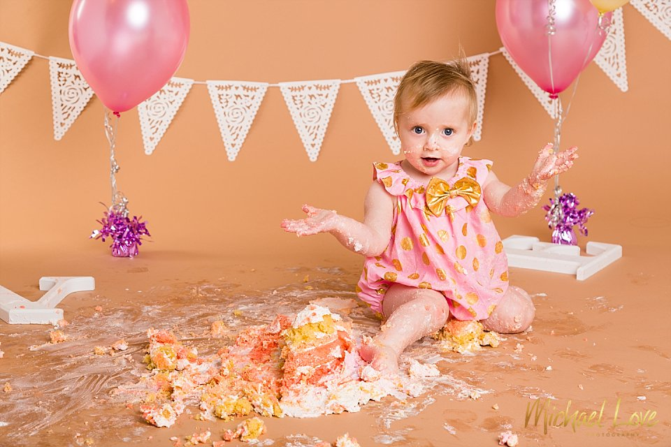 Baby girl in a cake smash studio photoshoot