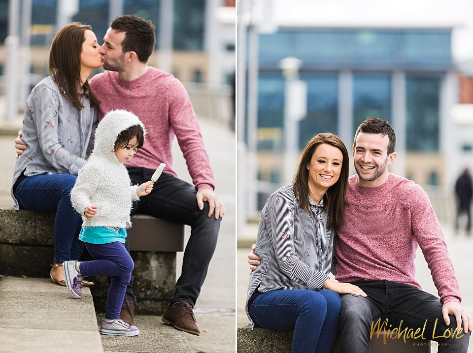 Couple laughing at being photobombed by a toddler with an ice pop