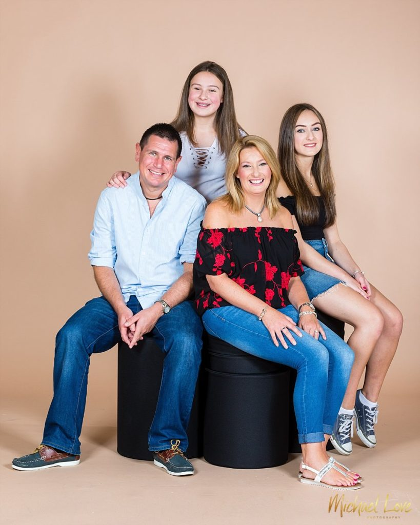 Studio portrait of family of four in Londonderry