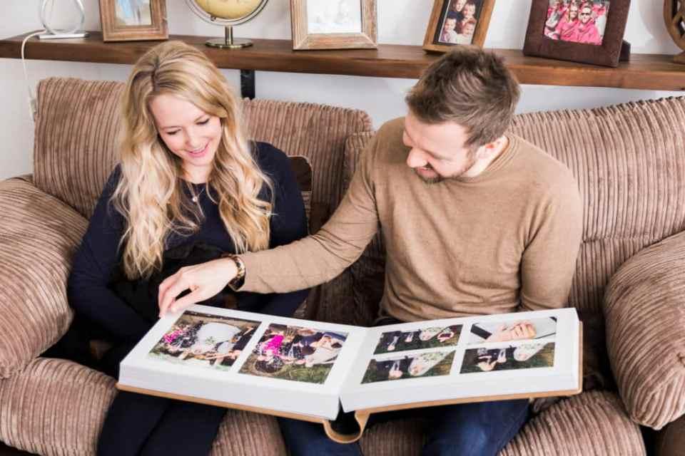 Couple browsing wedding album