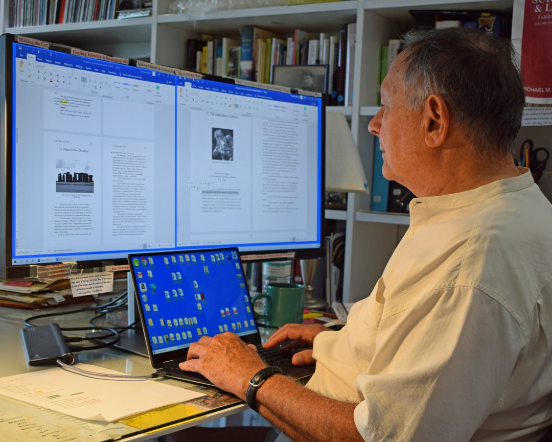 Photo of Michael M. Miguid Writing