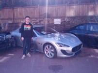 Me next to a Maserati GranTurismo Spor