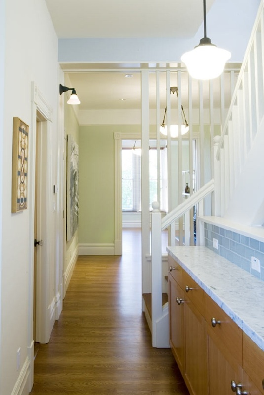 A narrow contertop in the hall adds funtional space