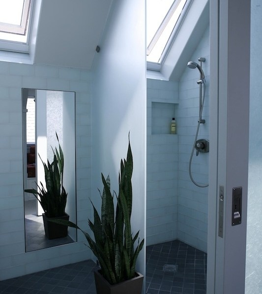 white bus tiled bathroom with skylights
