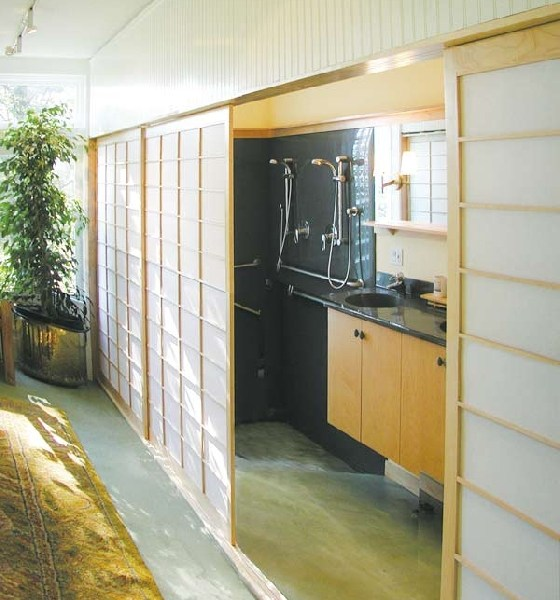 sliding panels open to bathroom and shower