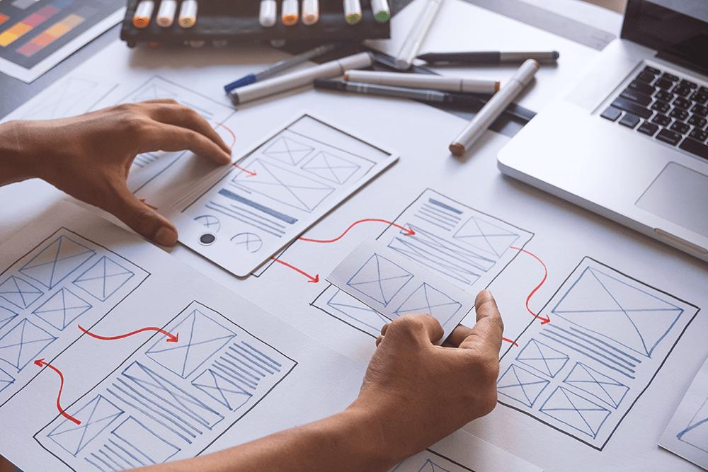 A graphic designer planning mobile design for a mobile application