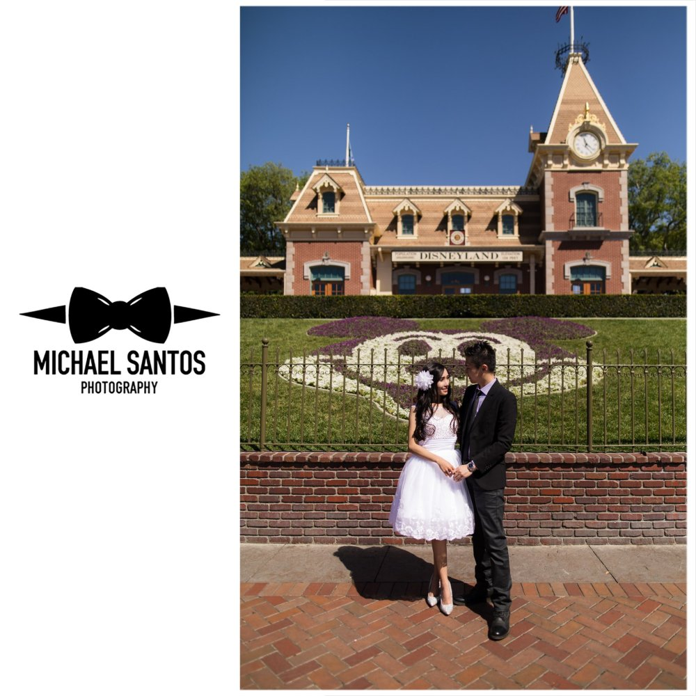 couple in front of railroad station during engagement session at disneyland