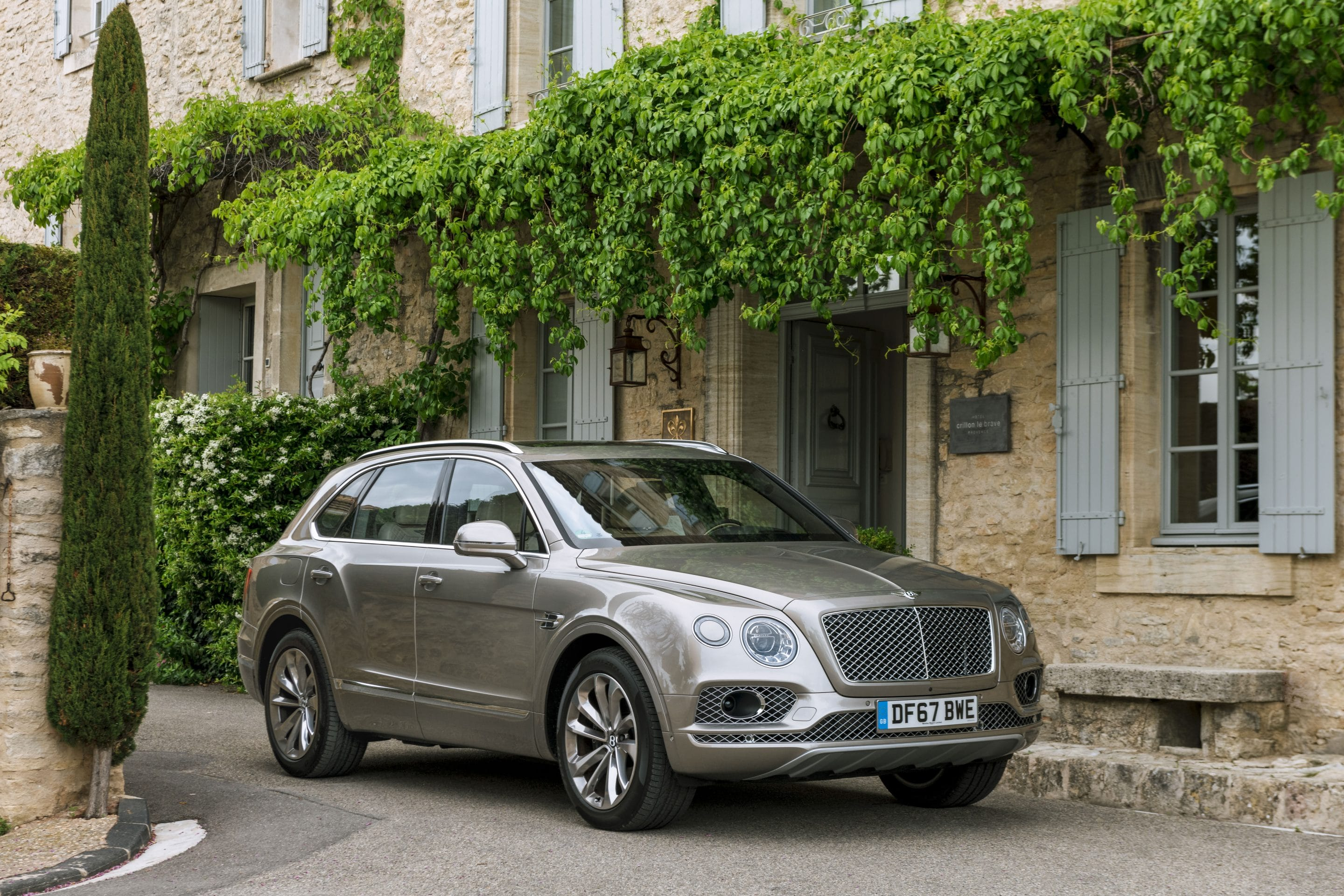 Commercial automotive photography of a Bentley Bentayga and cyclist Adrian Timmis by photographer Michael Schauer for Bentley Motors in the Provence region of south France