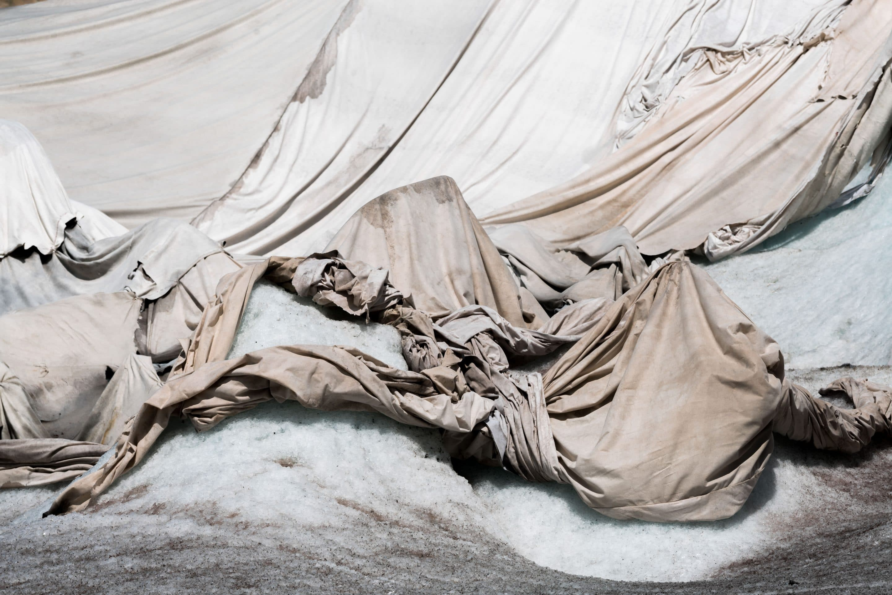 Fine art photographer Michael Schauer shoots the abstract landscape of Shrouds over a glacier in Switzerland to protect it from the sun in summer. This is but one example for how humans are finding solutions for dealing with man made climate change