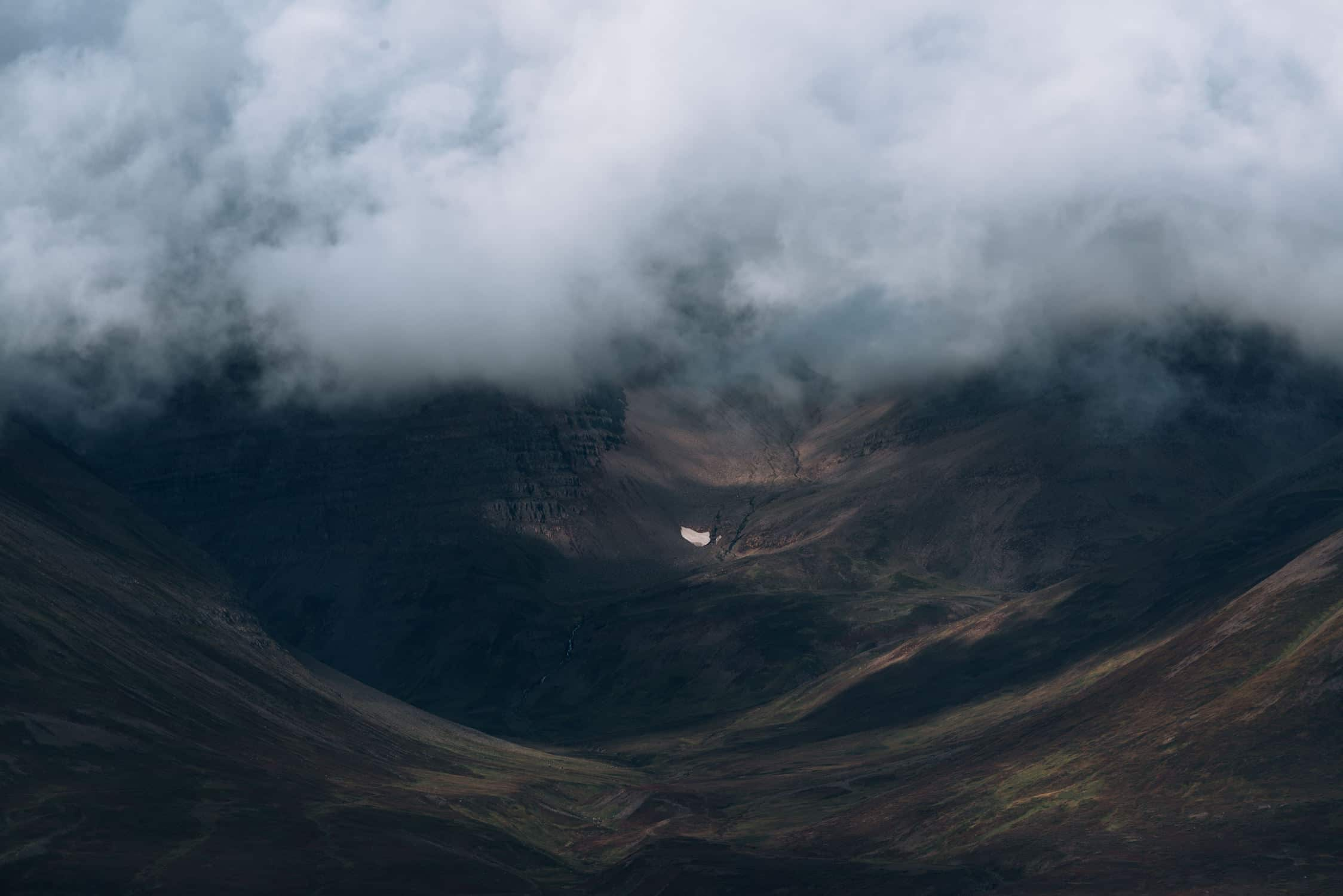 Abstract shapes and forms of water, rivers, glaciers and mountains in the moody Icelandic landscape captured by fine art photographer Michael Schauer