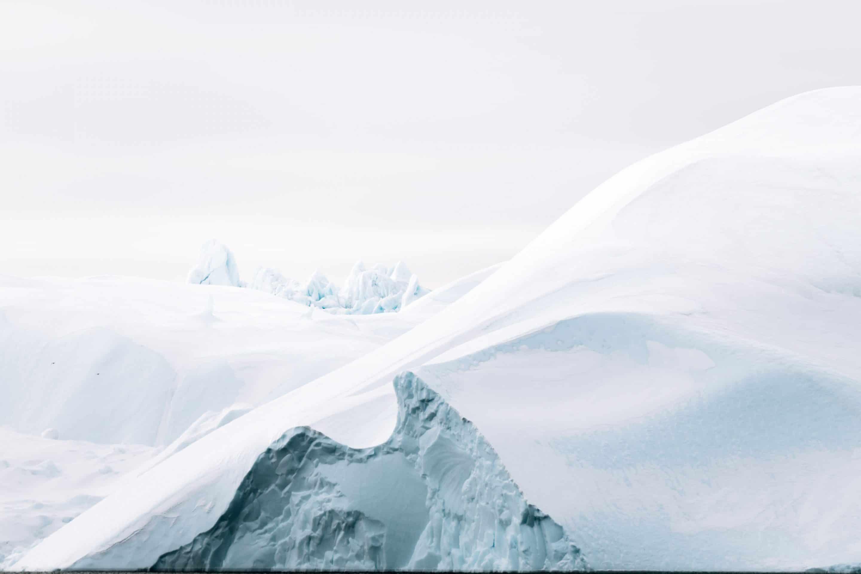 Minimalist fine art photographs of icebergs in Disko Bay, western Greenland by Michael Schauer