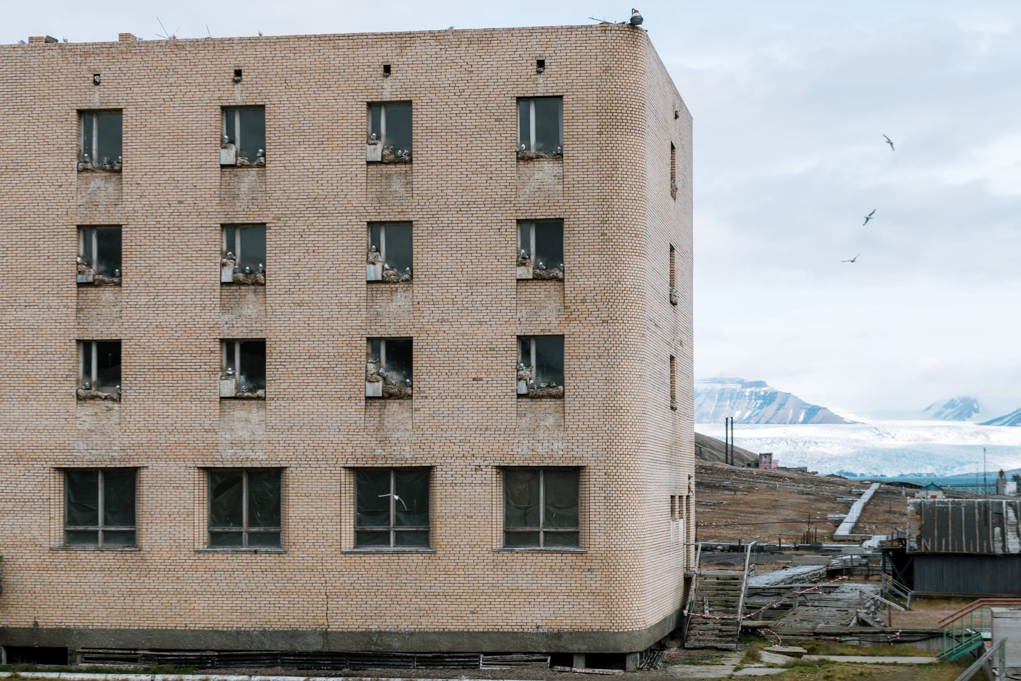 Pyramiden is a long lost settlement on the northern part of the Svalbard archipelago in northernmost Norway. It used to be a russian mining town but is now a time capsule and a lost place. By photographer Michael Schauer