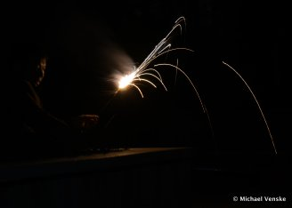 Chinese man with sparkler black background