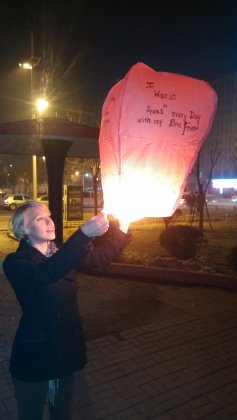 Sending Chinese lantern into the sky