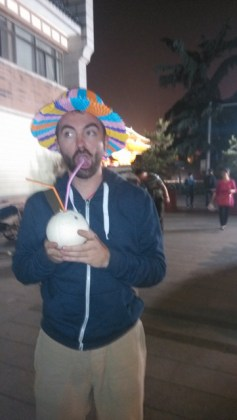 Michael Venske in a stupid hat drinking out of a coconut