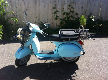 """My scooter became the official """"Thumbs Up"""" tour vehicle in Minneapolis for the Minnesota Fringe Festival."""