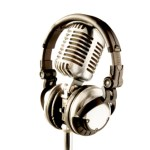 Vintage chrome microphone with headphones and white background