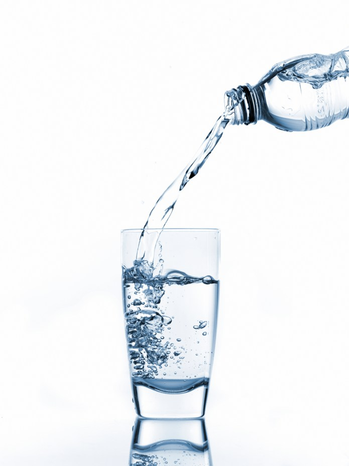 Glass filled with bottled water