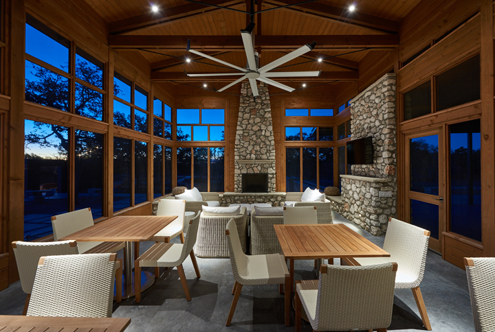 Outdoor dining is available via this cedar and stone screened summer porch.