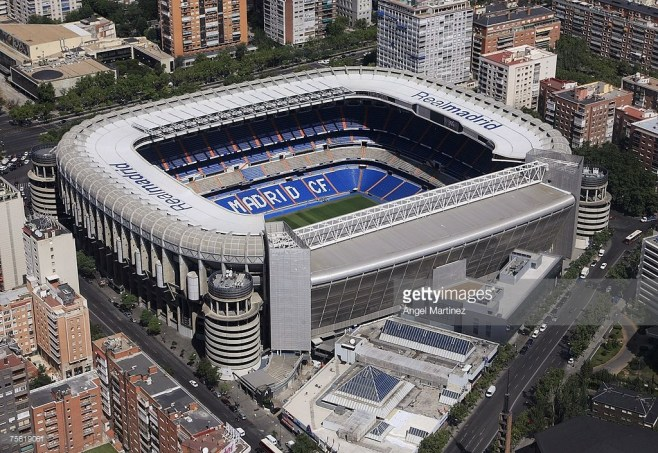 http://media.gettyimages.com/photos/an-aerial-view-of-real-madrids-santiago-bernabeu-stadium-on-july-23-picture-id75619061