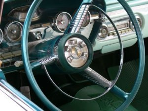 Ford Edsel shifter: pressing buttons in the center of the steering wheel