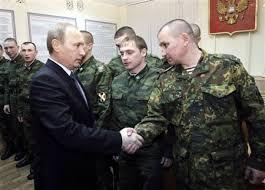 Le président Vladimir Poutine et ses soldats.
