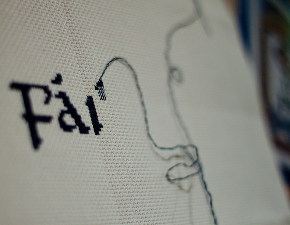 "Day 061 I've taken up cross stitching again.  This is going to be a Celtic design that says, ""Cead Mile Failte"" which means One Hundred Thousand Welcomes.  manual  f/1.8  1/1000sec  ISO800  In Lightroom I bumped up the exposure because even though my meter reading said it was properly exposed, somehow it came out dark.  Is that because it's all white?"