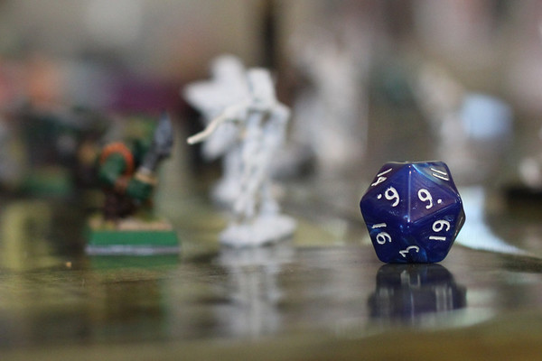 Day 204  We had friends over for Pathfinder today.  The twenty sided die is an important part of the game.  50mm Manual ISO1600  f/3.2  1/80sec