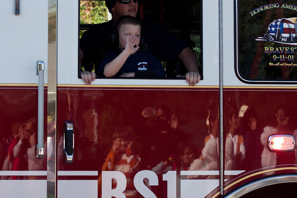 Day 287  We went to the King George fall festival parade today.  I didn't realize it until I was processing my photos, but I captured the reflection of the parade-watchers in the side of one of the noisy fire engines that passed by.  Manual 50mm  ISO100  f/3.5  1/500sec  Cropped and increased contrast and clarity in Lightroom.