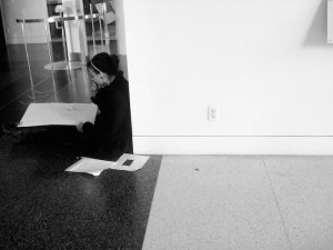Girl sitting on floor thinking and writing about content marketing