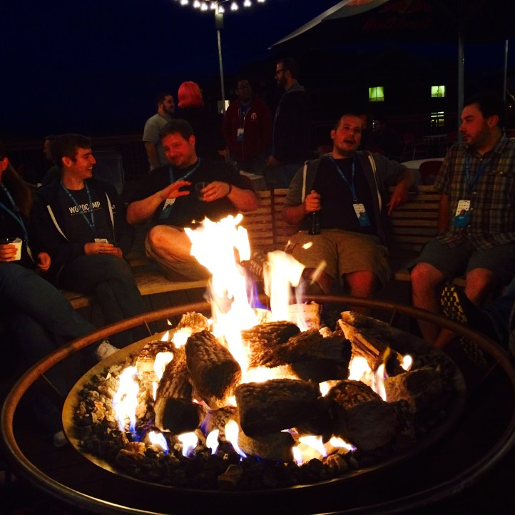 Chatting around the fire after dinner.