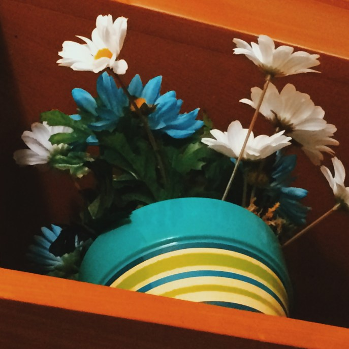 Pretty fake flowers on top of my shelf.