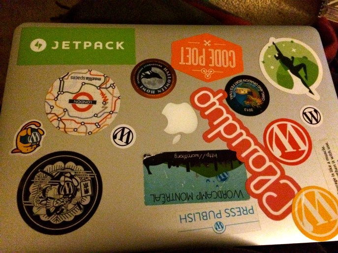 My work laptop, in all its stickered glory.
