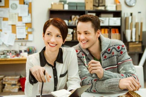 Chyler Leigh stars as Sloan, the driven department store employee who is determined to get the window dresser job at McGuire?s department store over fellow employee Jake (Paul Campbell). Photo: Chyler Leigh, Paul Campbell