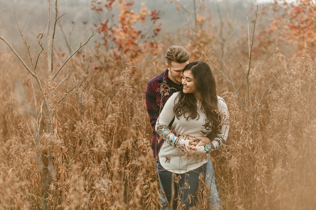 Engagement-Photo-Couple-Standing-Field-Weeds-Autumn-Fall-Martinsville-Indiana