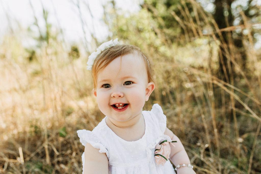 Spring-First-Birthday-Girl-Smile-Laugh