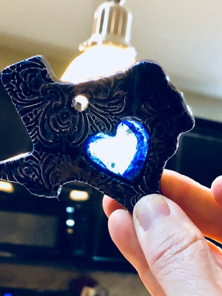Texas clay ornament with blue glass heart