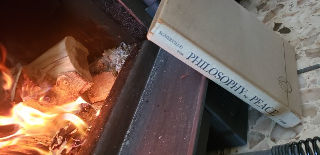 Philosophy of Peace book cover at a fireplace.