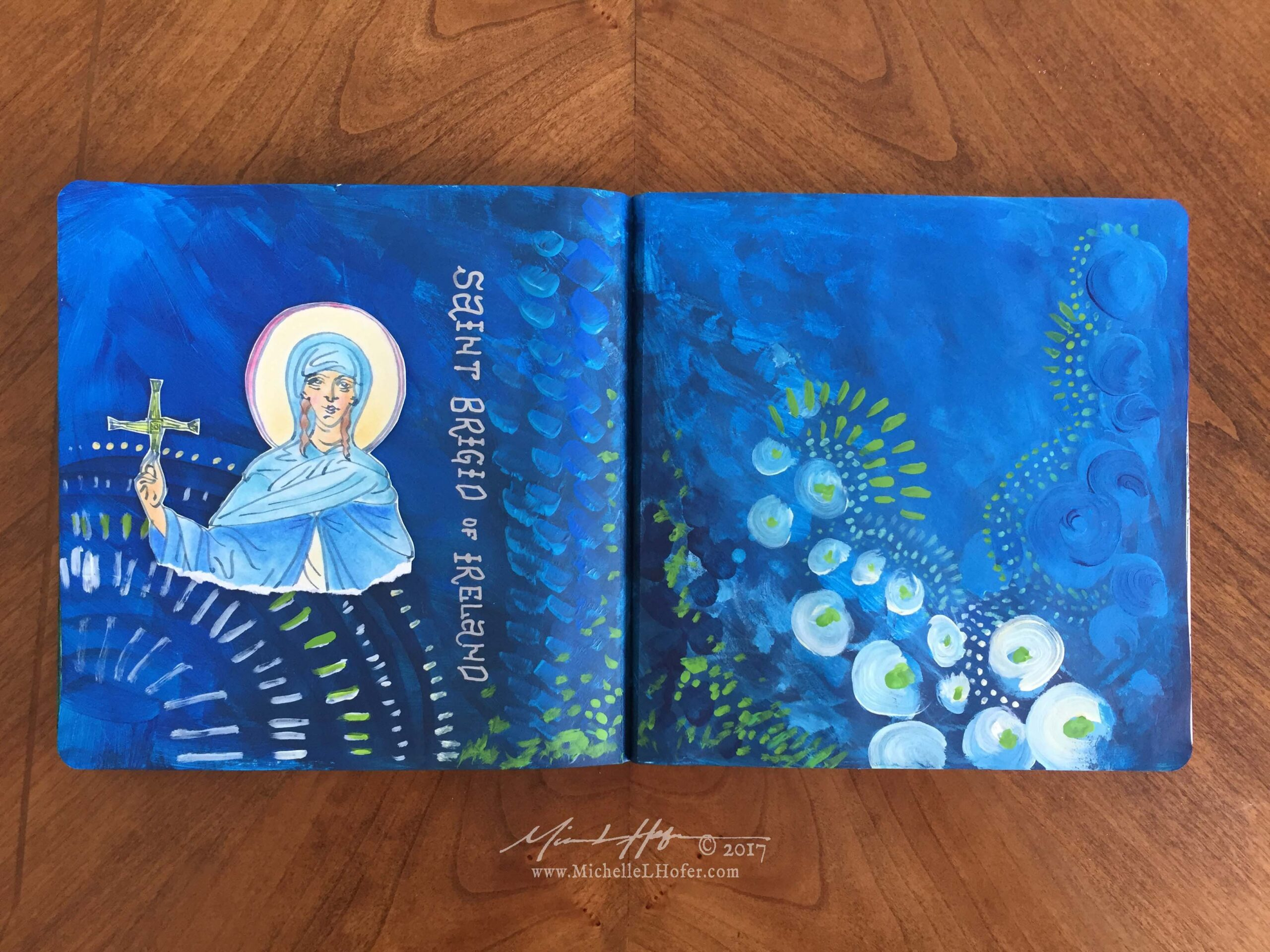 The Generosity of Saint Brigid - Abstract acrylic painted double-page book spread featuring a pen and ink portrait of Saint Brigid of Ireland with hand lettered name from the Book of Saints by Michelle L Hofer.