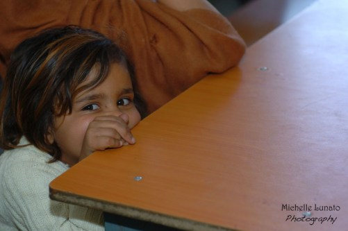 I loved how this child was trying to hide and yet peek out at me.