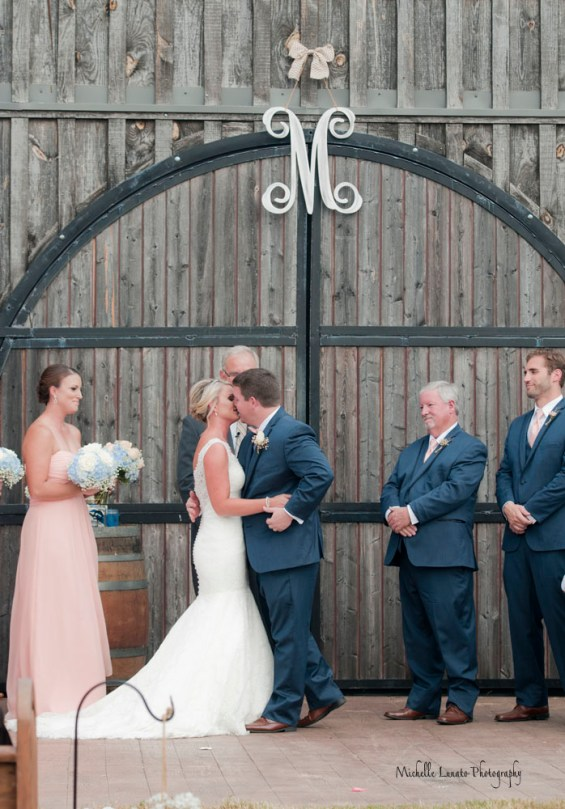 The first kiss, and all in front of the elegant barn door.