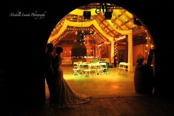 As the night came to a close, the warm glow of the reception made a romantic setting for the couple.