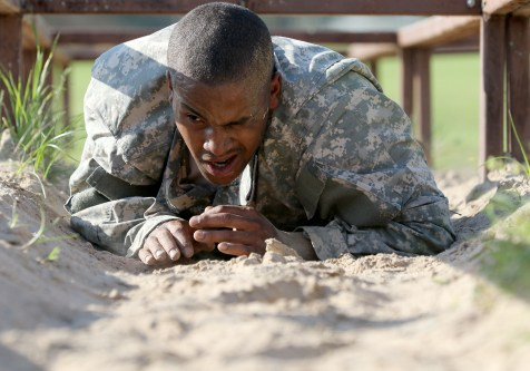 Army Reserve Spc. Michael Parrish Jr., a Petersburg, Virg. native and human resources specialist with Alpha Company, 2-319th, 104th Training Division (LT), completes the low-crawl obstacle during the 2017 108th Training Command (IET) Best Warrior of the Year Competition at Camp Bullis, Texas, March 19-24, 2017. Parrish earned the title of Soldier of the Year for the 104th Training Division (LT). (U.S. Army Reserve photo by Maj. Michelle Lunato.)