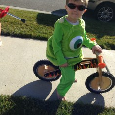 A kid, some shades and his bike.